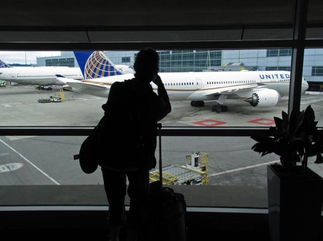 J taking plane photo